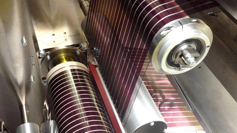 Flexible solar cells being produced.